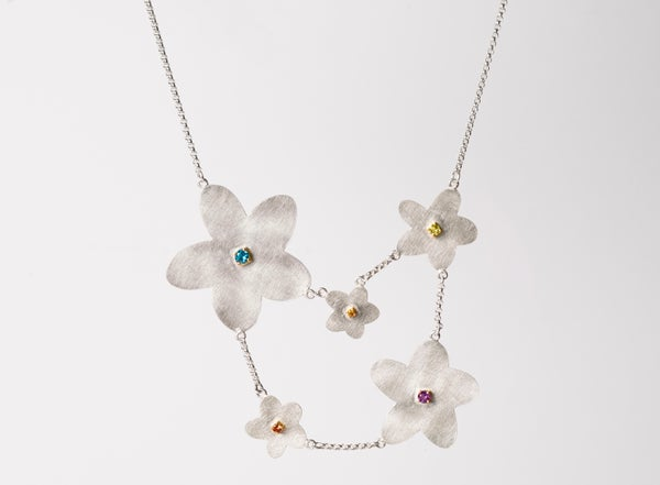 Image of necklace silver gold coloured stones