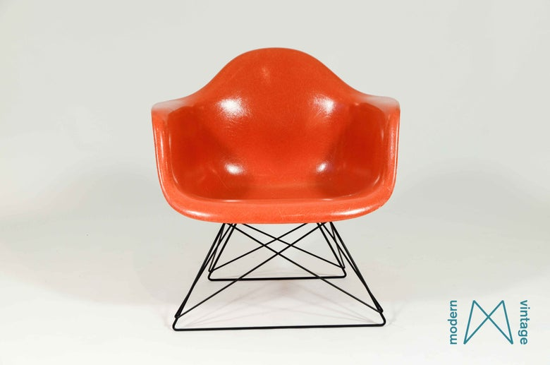 Image of Charles and Ray Eames Fiberglass Side Chair Orange Cats Cradle