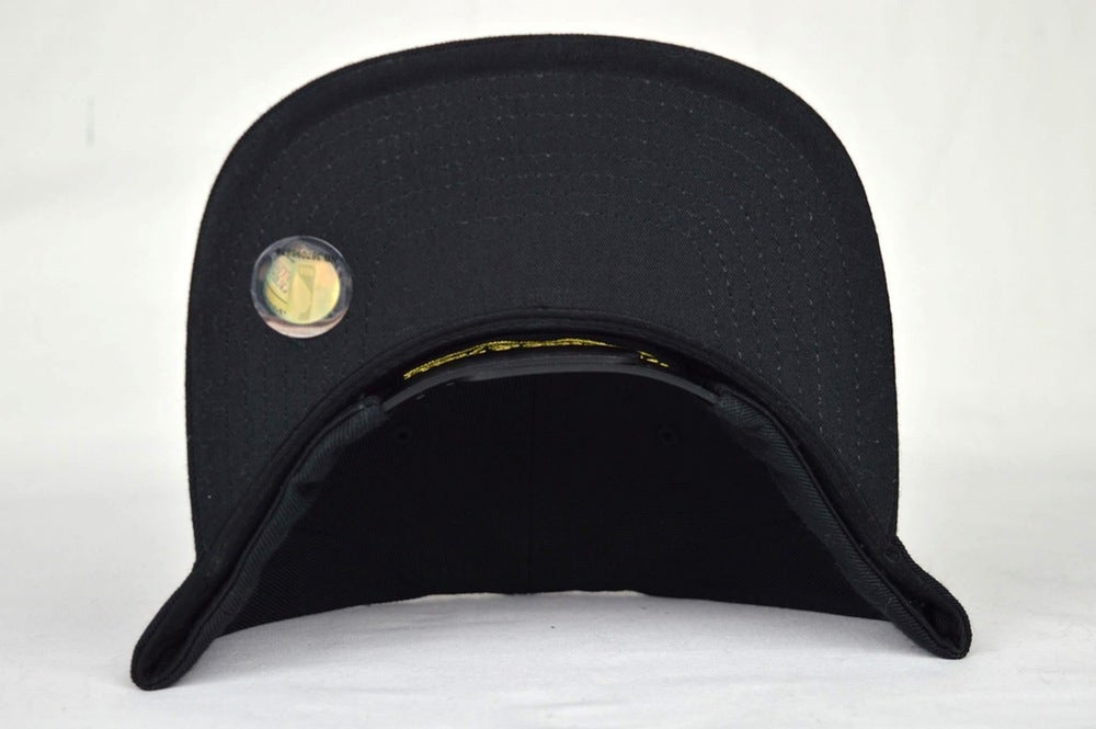Image of TORONTO HUSKIES BLACK & GOLD MITCHELL & NESS SNAPBACK