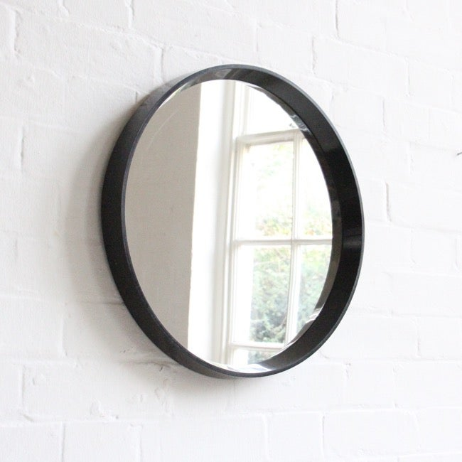 Image of Black round mirror c 1960