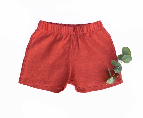 Image of burnt red linen shorts