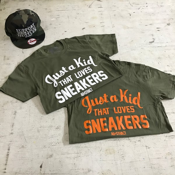 """Image of JUST A KID THAT LOVES SNEAKERS """"OLIVE"""" T-SHIRT"""
