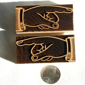 Image of A pair of 8 line Open Manicules