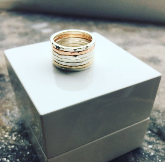 Image of Silver and 9ct Hammered Stacking Rings