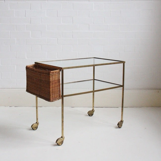 Image of midcentury brass trolley with wicker rack