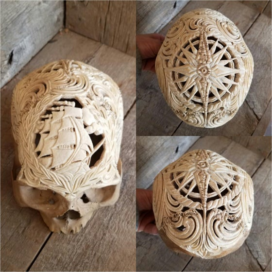 "Image of Carved human skull ""the human voyage"""