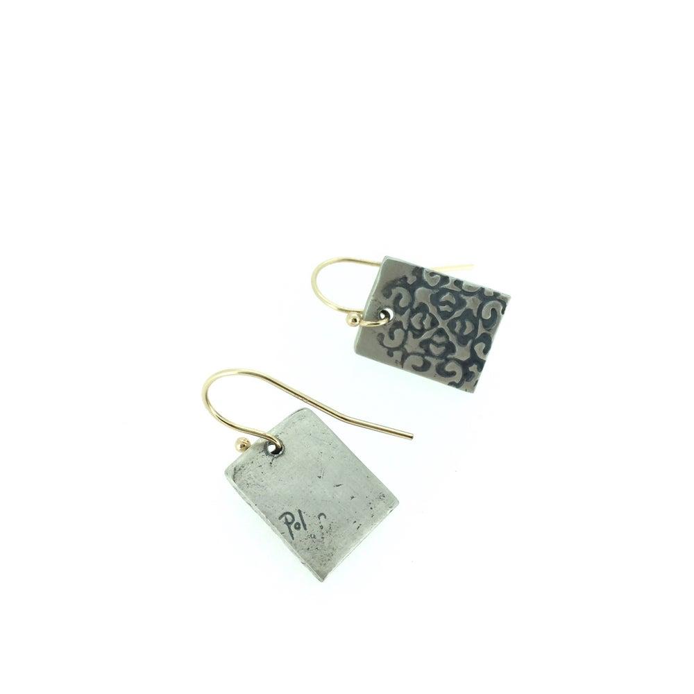 Image of silver medallion earrings