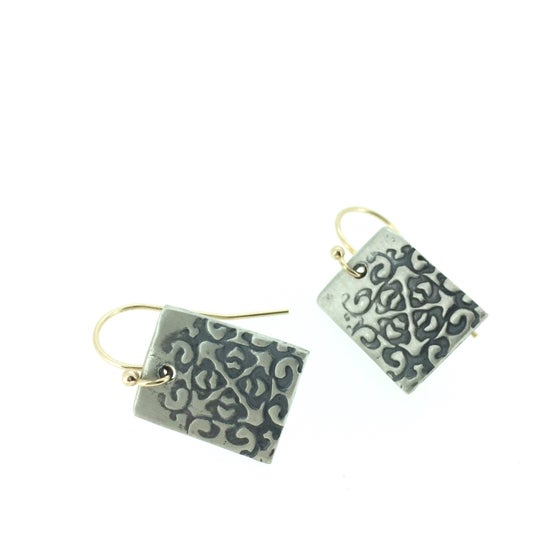 Image of silver medallion earrings