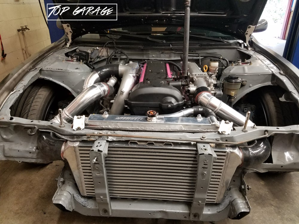 Exhaust and intercooler fabrication top garage for Garage auto fab ennery