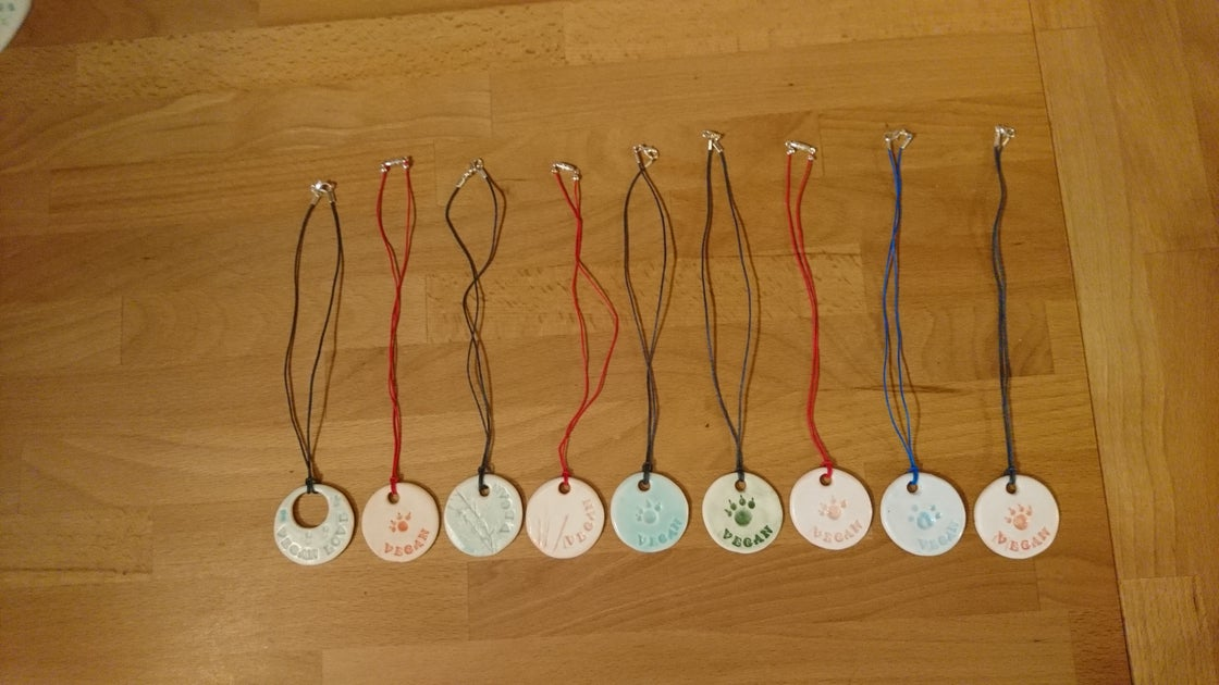 Image of Porcelain pendant on cord with fastener