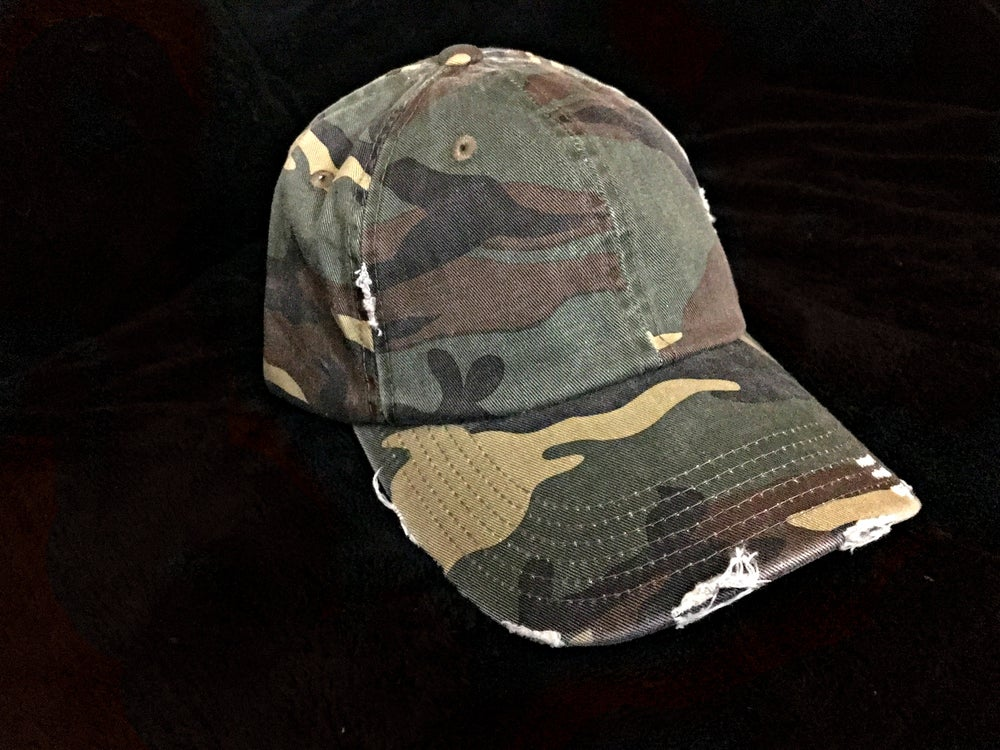 Image of Faded + distressed camo cap