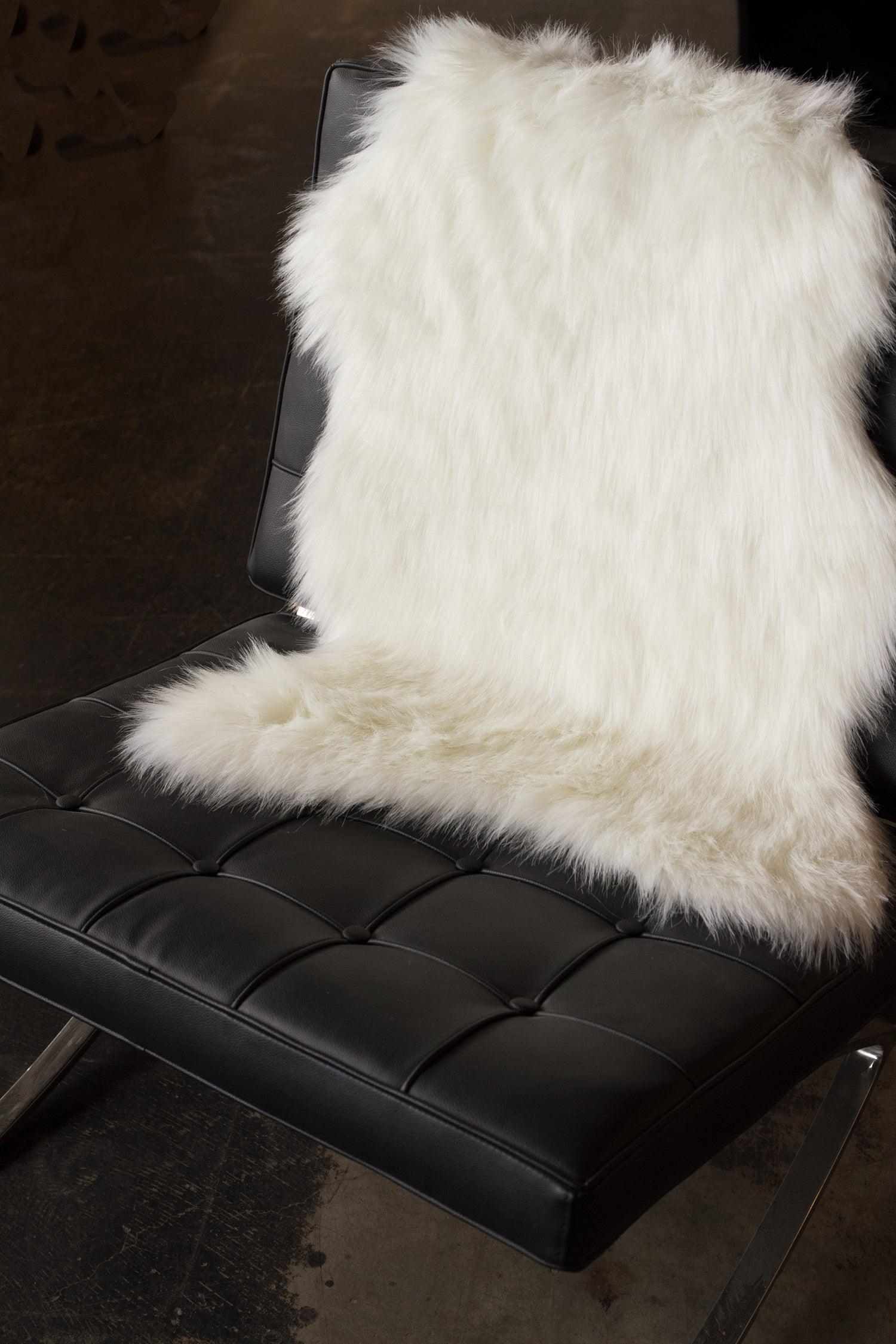 Image of 676685029706 GORDON FAUX SHEEPSKIN THROW 2'X3' OFF WHITE