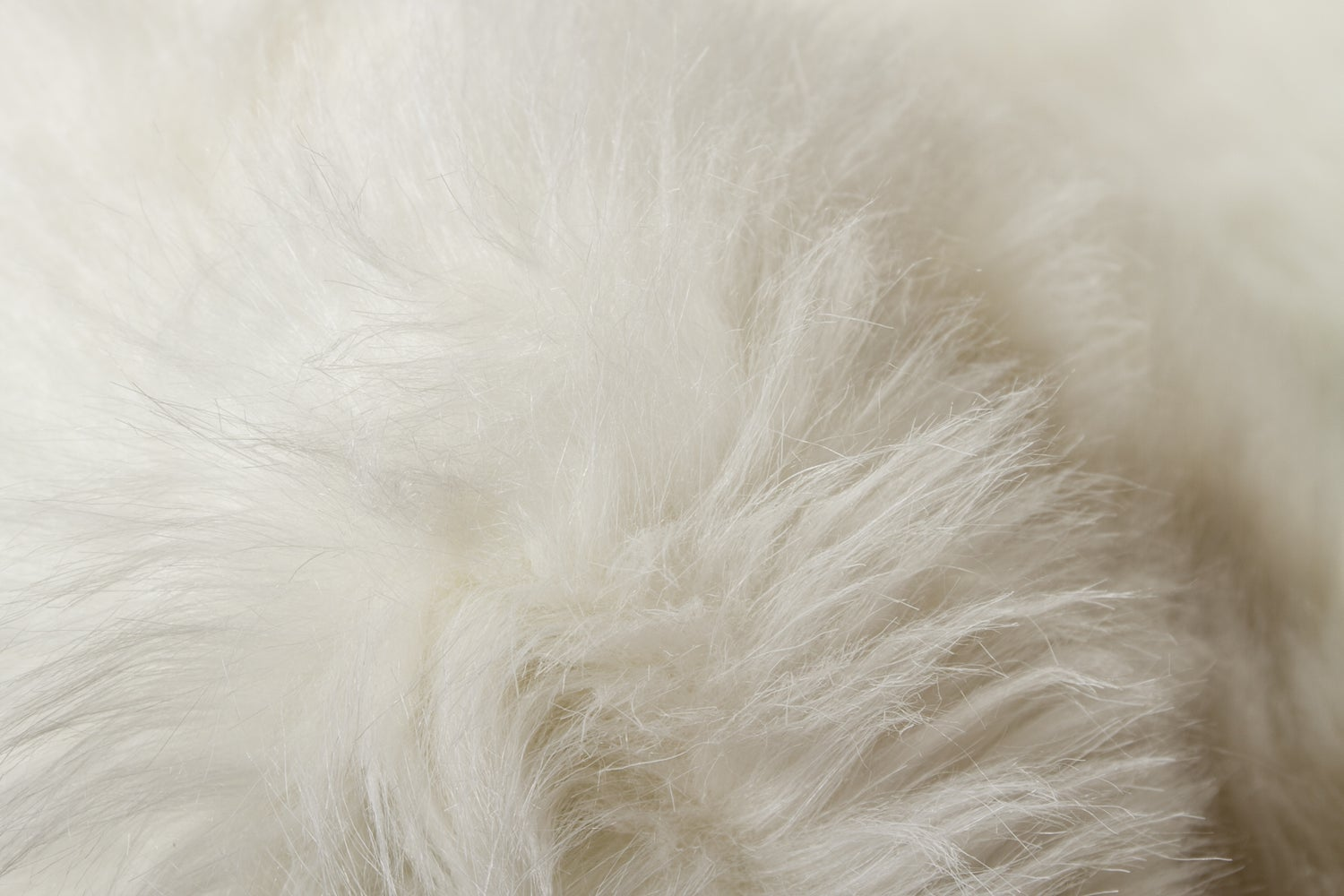 Image of 676685040978 GORDON FAUX SHEEPSKIN RUG DOUBLE  2' X 6'  OFF WHITE