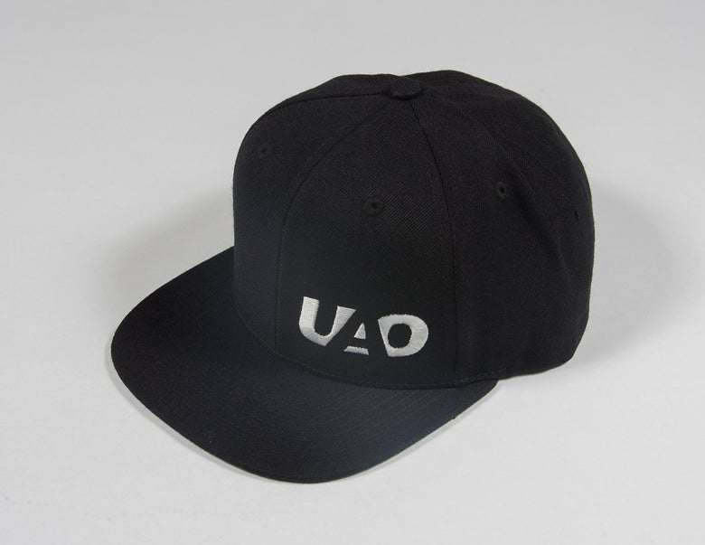 Image of UAO Clothing Co. Embroidered LM Logo Trucker Hats (Black)