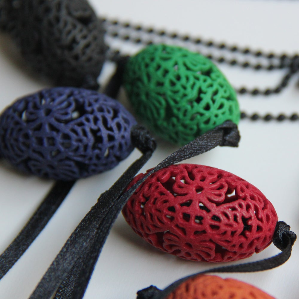 Image of 3D printed bead OVAL.floral