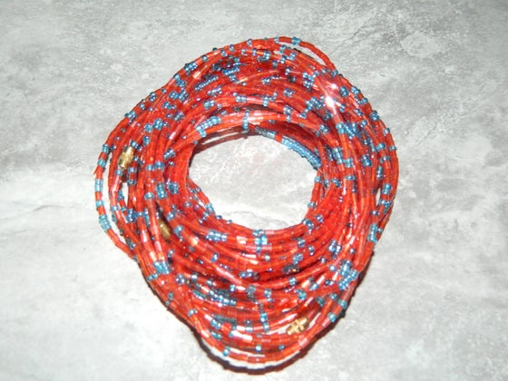 Image of Red and light blue glass bead