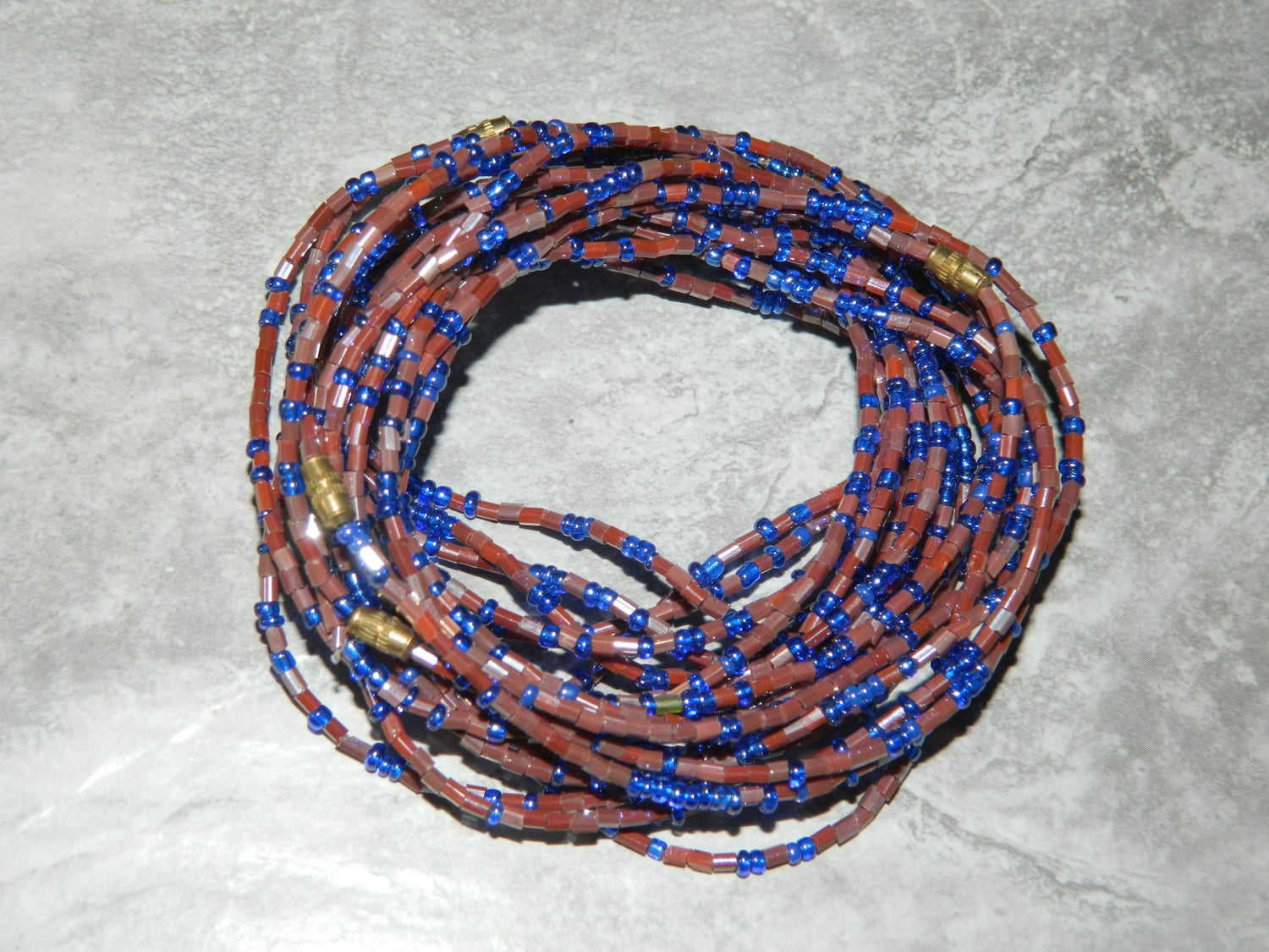 Image of Maroon and blue glass waist bead