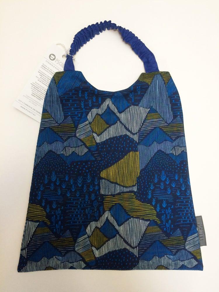 Image of Bavoir élastique | Montagnes & cactus | Bleu nuit, bleu roi & moutarde