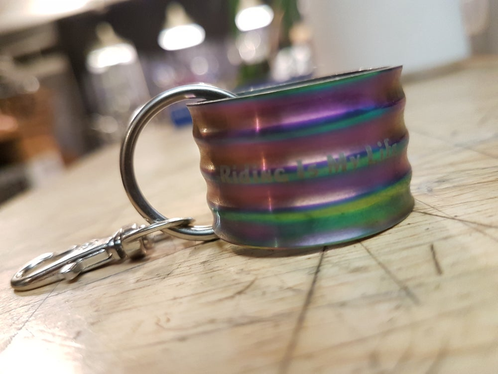Image of Riding is My Life RISK Oil Slick Ti Headset Spacer Keyring