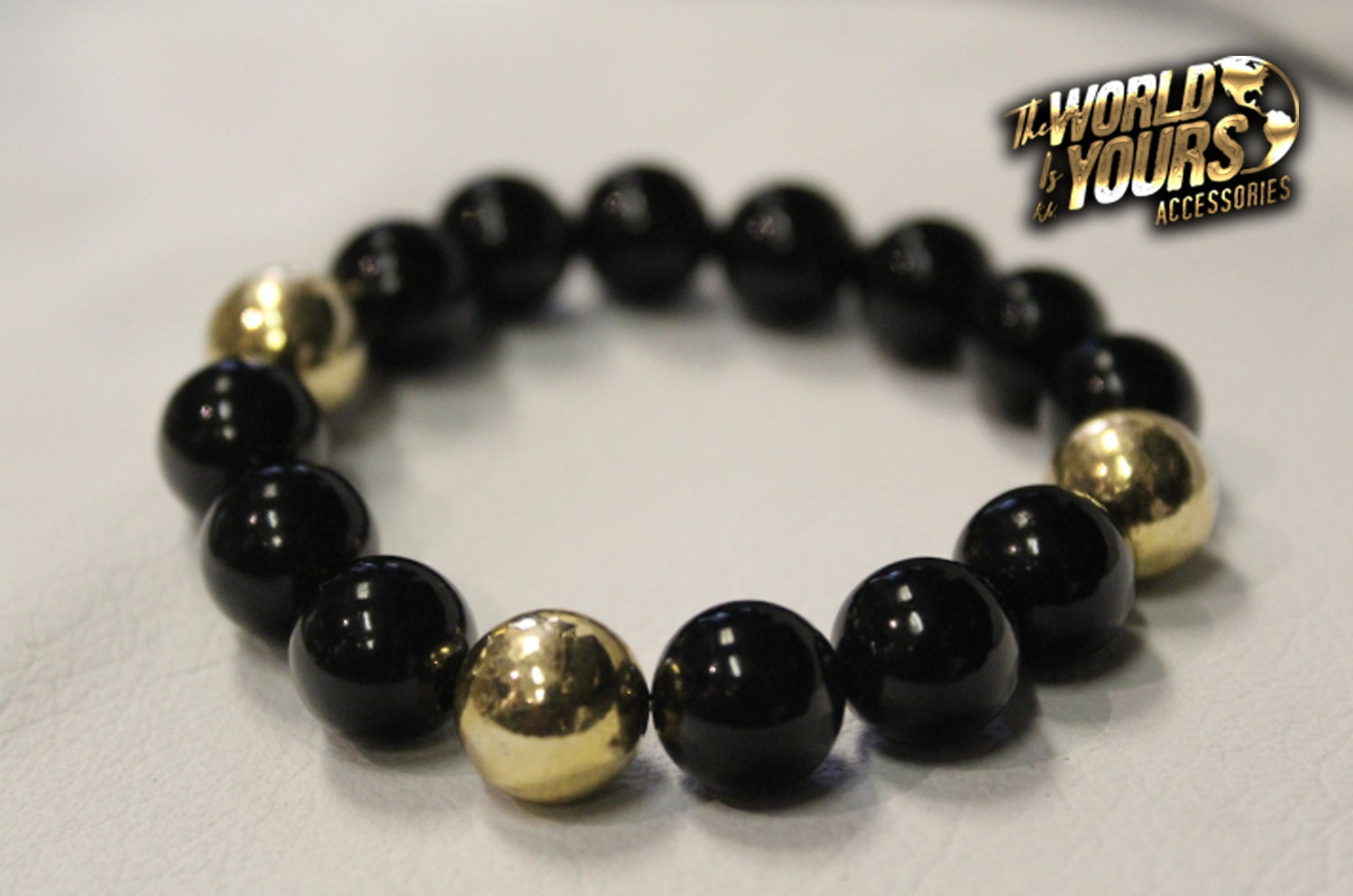 Image of TWIY APPAREL BLACK&GOLD BRACELET