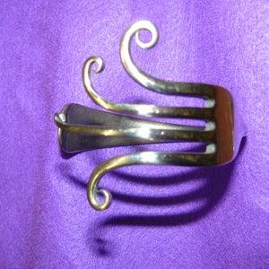 Image of forked swirly bangle