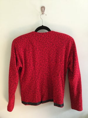 Image of red jacket with black detail