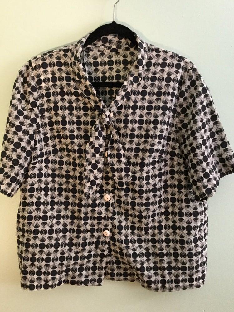 Image of circle pattern tie collar top