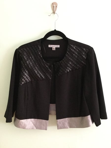 Image of black crop blazer with faux leather detail