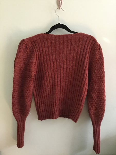 Image of burnt orange puff sleeved knit sweater
