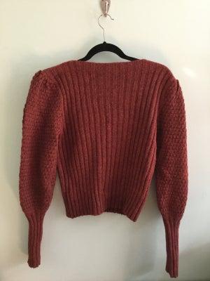 Image of burnt orange puff sleeved knit sweater
