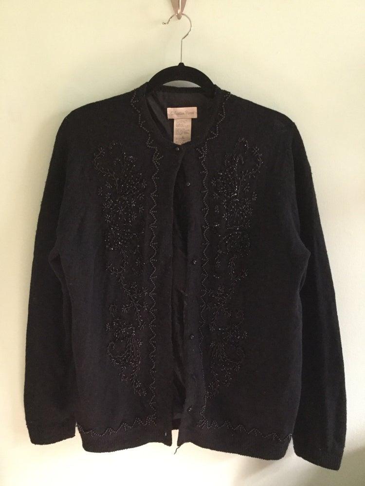 Image of black cardigan with beaded detail