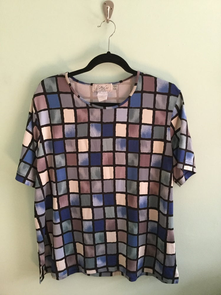 Image of blue hue boxed shirt