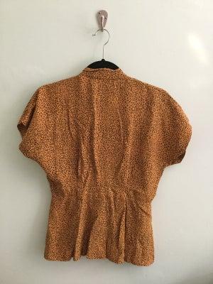 Image of leopard print blouse