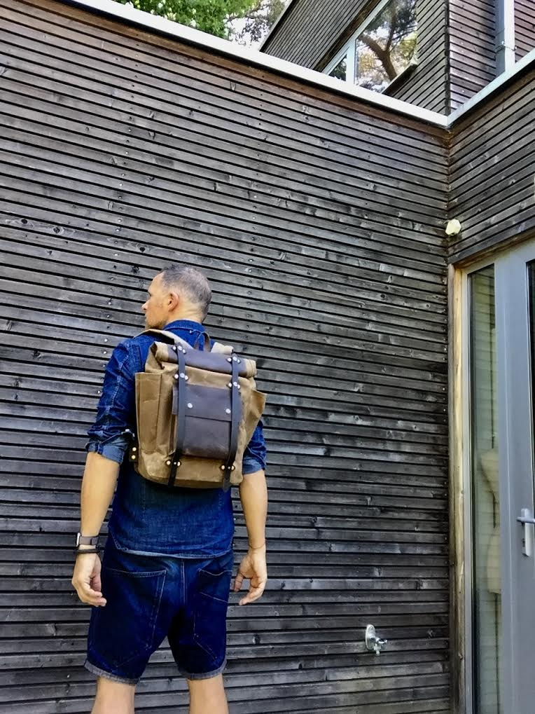 Image of  Hipster Backpack in waxed canvas with roll up top and double bottle pocket