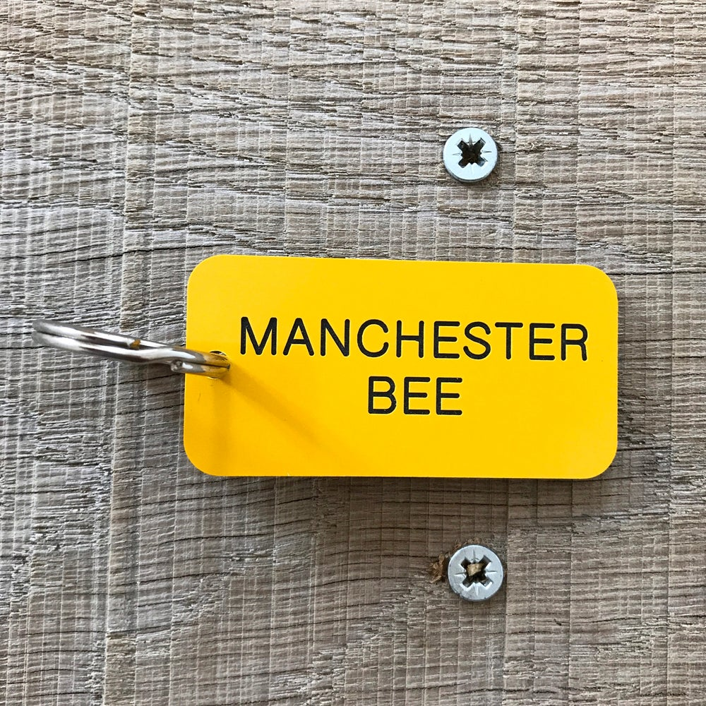 Image of Manchester Worker Bee locker keyring in Yellow + Black