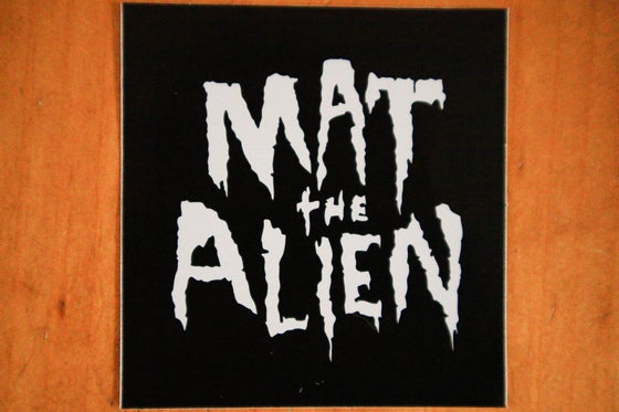 "Image of Sticker - Mat The Alien Logo 3"" x 3"" (Art by Karimo)  x 5"