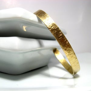 Image of birch bark cuff. bracelet. brass.