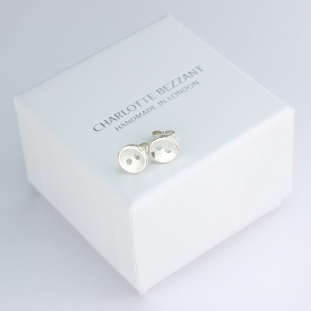 Image of small button stud earrings, smooth 2 hole buttons