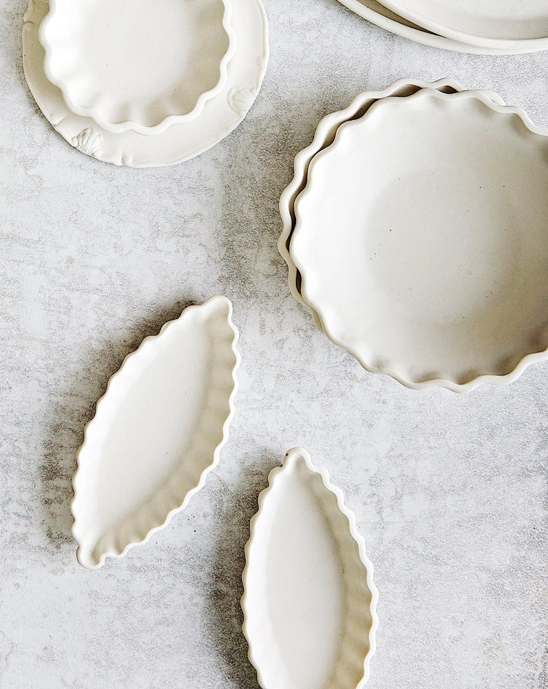Image of fluted navette dish in white