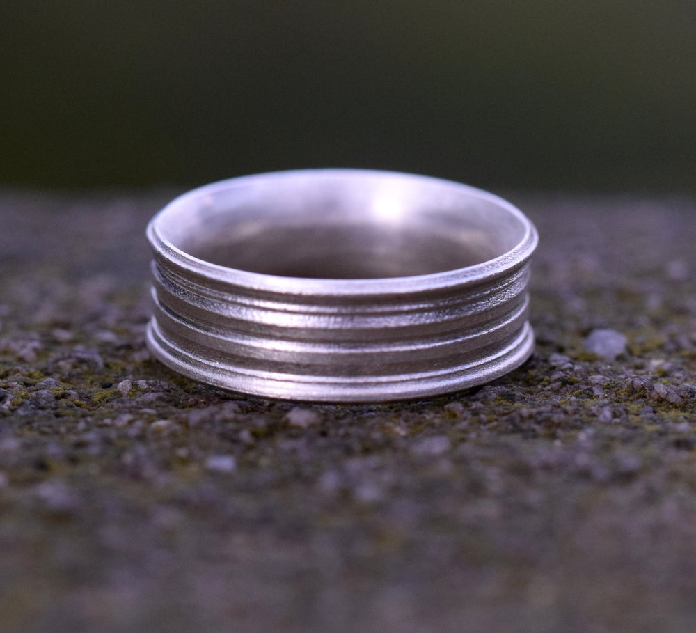 Image of Sterling Silver Round, grooved 'Strata' Ring. 7mm diameter band with a rounded, easy fit inside