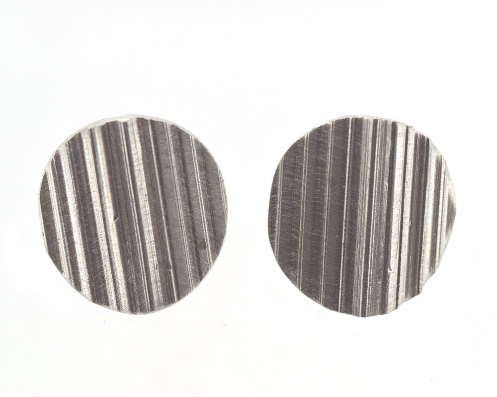 Image of Round Stud earrings formed from shaped, textured Sterling Silver sheet. 13mm diameter discs