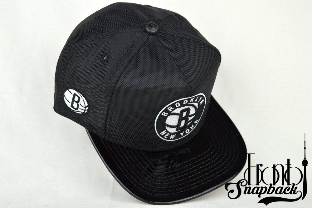Image of BROOKLYN NETS CUSTOM BLK NYLON/BLK PATENT LEATHER NEW ERA GLOW STRAPBACK CAP SPACE JAM 11