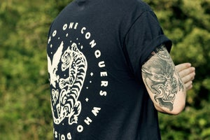 Image of 'No One Conquers Who Doesn't Fight' Tee.