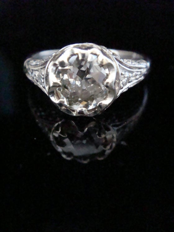 Image of Art Deco Platinum 1.64ct Diamond solitaire ring with intricate diamond shoulders