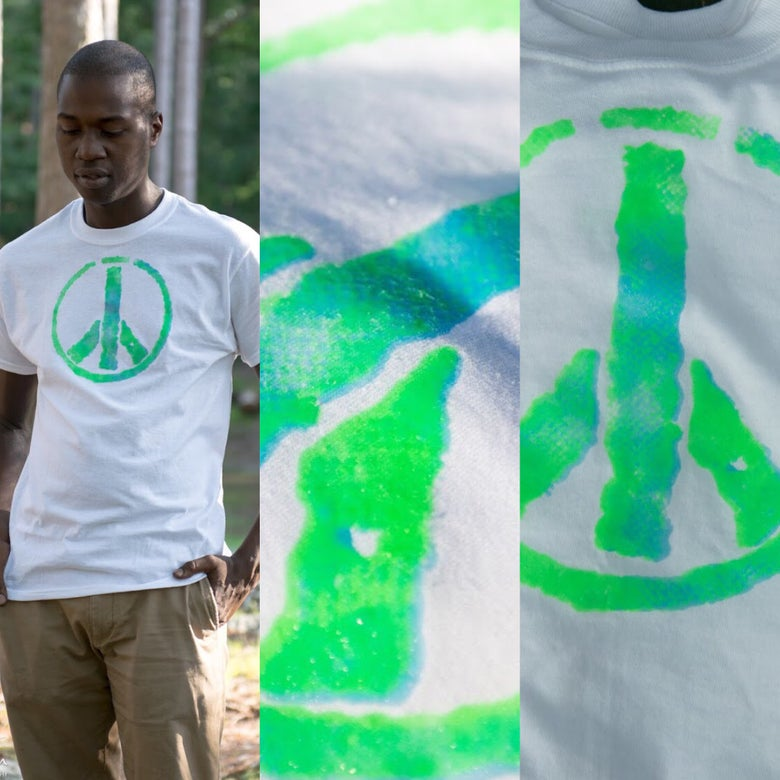 Image of Blue and Green Peace Sign shirt and non slip socks.