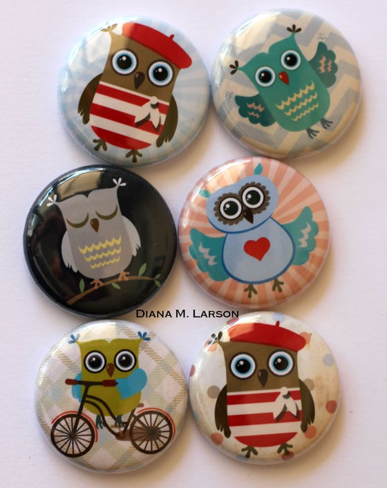 "Image of OWL 1"" Flair buttons"