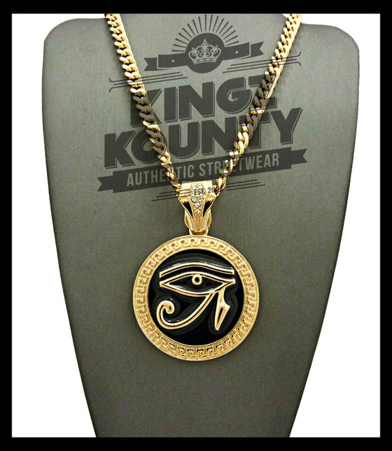 Image of EYE OF RA BLACK-GOLD-MEDALLION