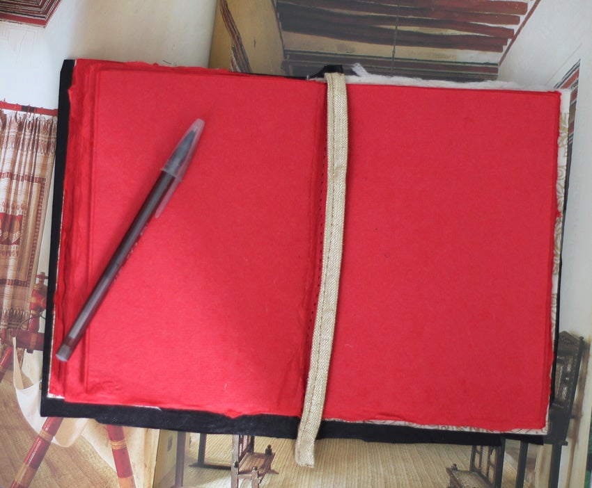 Image of 'Stormborn' notebook - red paper pulp
