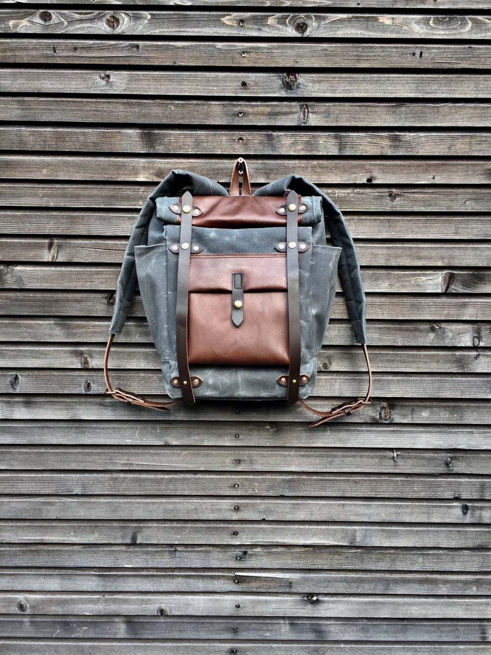 Image of Backpack in waxed canvas,  medium size / Hipster Backpack with roll up top and double bottle pocket