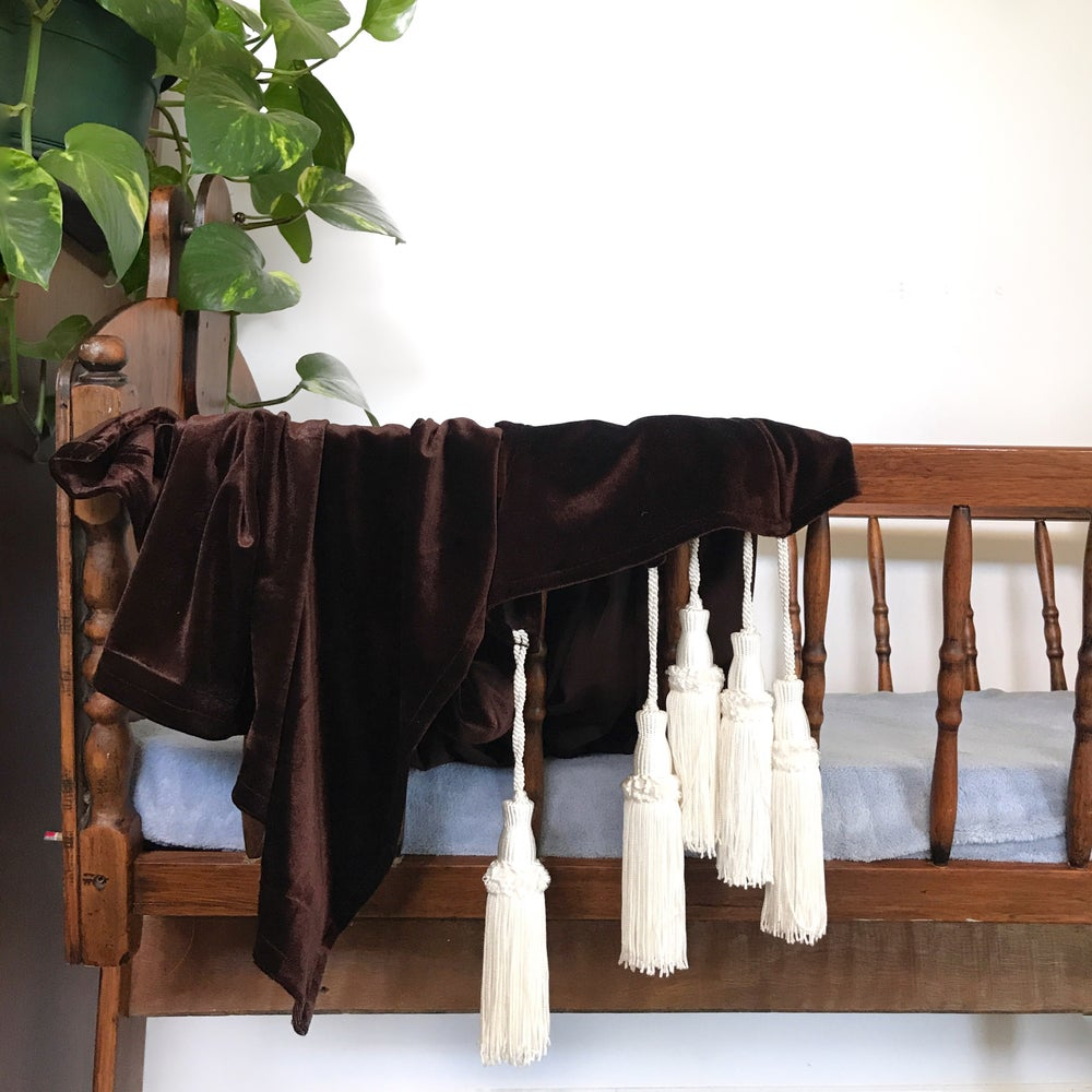 Image of 'neutral'  jewel tassel throw